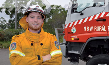 Smiling NSW RFS volunteer with a truck