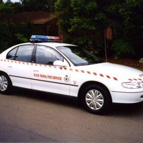 1999 Holden Commodore with NSW RFS Markings and Red and Blue Roof Light Bar Code 3 MX7000