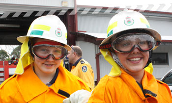 Two young female volunteers wearing Personal Protective Clothing (PPC)