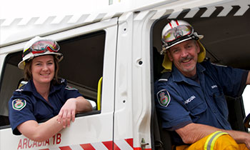 Brigade members sitting a NSW RFS fire truck