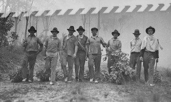 Historical picture of landholders fighting a fire